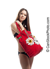 Yong woman show her red beach bag isolated