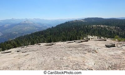 Yosemite summit panorama of half dome, view after hiking in Yosemite National Park at Sentinel Dome. Aerial view of popular El Capitan from Sentinel Dome. Summer travel in United States, California.