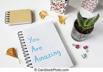 You are amazing written in notebook