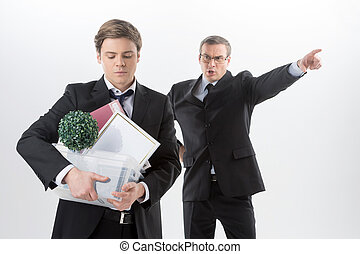 You are fired! Angry middle-aged man in formalwear shouting...
