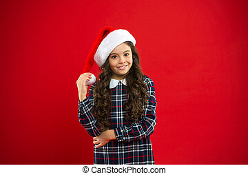 You are next. Present for Xmas. Childhood. New year party. Santa claus kid. Christmas shopping. Happy winter holidays. Small girl. Little girl child in santa red hat
