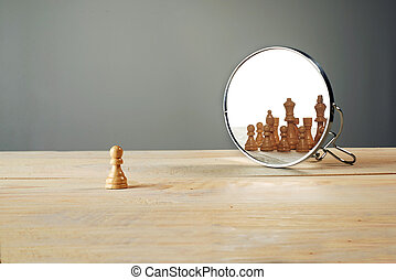 You are not alone. Chessmen in front of the mirror