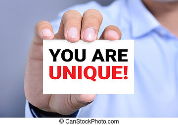 YOU ARE UNIQUE !, message on the card hold by a man