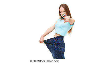 You can do it! Young slim woman with large jeans pointing finger