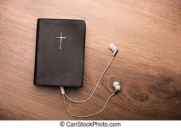 You can listen to your favorite psalms - Close up of a Bible...