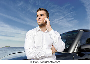 You can reach me anytime! - Handsome young businessman ...