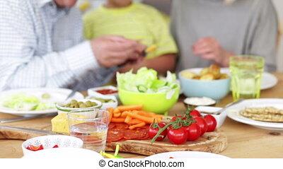 You Eat It, Grandad! - Little boy is feeding his grandfather...