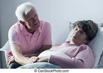 You must recover for me... - Senior man supporting his ill...