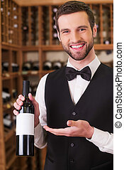 You should try this wine. Confident young man in waistcoat...