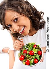 Youg woman eating healthy salad
