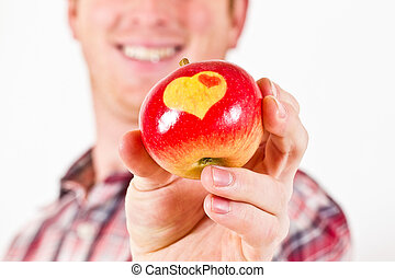 Youn Man with an Apple with Hearts
