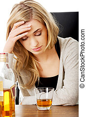 Yound woman in depression, drinking alcohol - Yound...