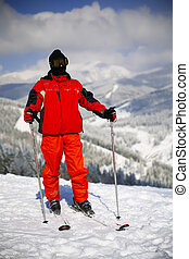 Young active man skiing in mountains