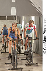 Young Active People Gym Cycling