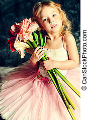 young actress - Pretty little girl ballerina in tutu posing...