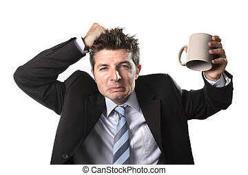 young addict business man in suit and tie holding empty cup of coffee anxious