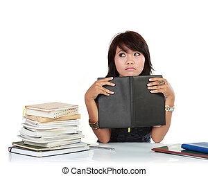 Young adult asian woman with books