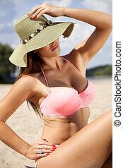 beautiful brunette woman in pink bikini