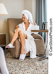 Young adult beautiful woman in hotel suit