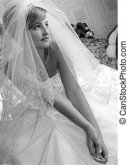 Young adult bride in veil
