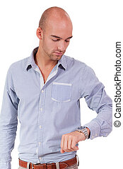 young adult business man looking at watch portrait