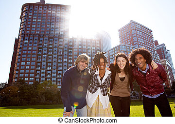 Young Adult City - A group of young adults in a city park -...