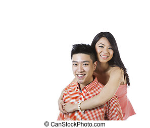 Young Adult Couple Expressing Happiness Together