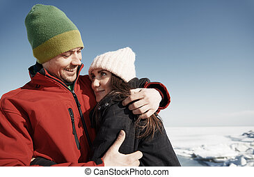 Young adult couple having fun in winter landscape