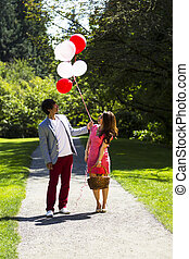 Young Adult Couple having Fun while going for a walk