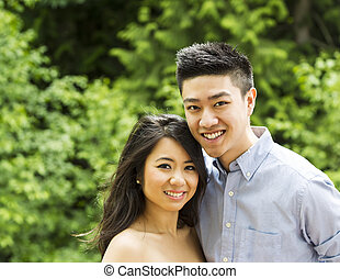 Young Adult Couple holding each outdoors