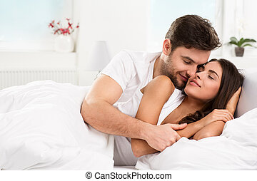 Young adult couple in bedroom - Young adult heterosexual...