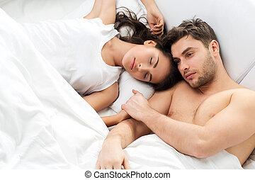 Young adult couple in bedroom - Young adult heterosexual...