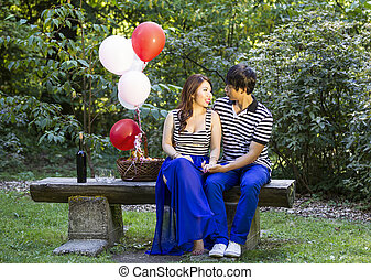 Young Adult Couple Preparing for an Outdoor Picnic