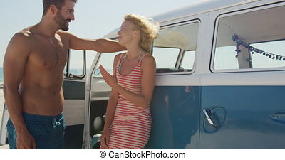 Young adult couple relaxing by their camper van 4k - Close ...
