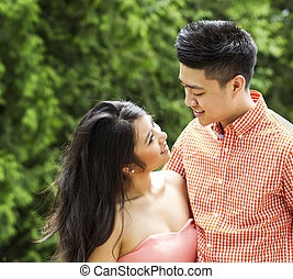 Young Adult Couple sharing a romantic moment outside