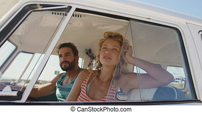 Young adult couple sitting in a camper van 4k - Close up of ...