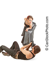 Young adult female Caucasian model being photographed in studio by young male photographer.