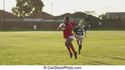 Young adult female rugby match - Front view of a young adult...