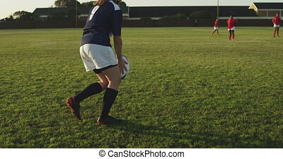 Young adult female rugby match - Rear view of a young adult ...
