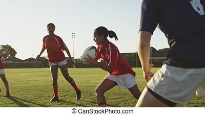 Young adult female rugby match - Side view close up of a ...