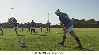 Young adult female rugby match - Side view of a young adult ...