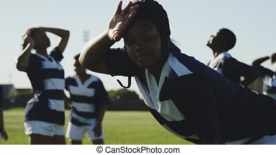 Young adult female rugby team - SIde view of a young adult ...