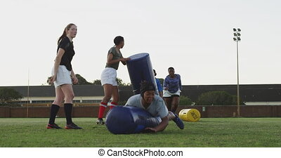 Young adult female rugby team training - Front view of a ...