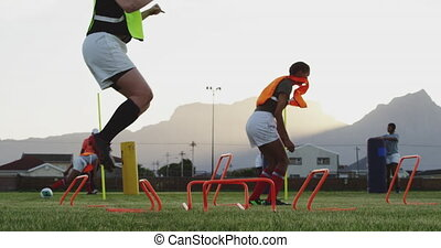 Young adult female rugby team training - Side view of a ...