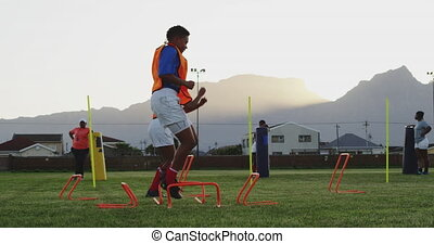 Young adult female rugby team training - Side view of two ...