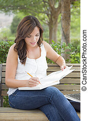 Young Adult Female Student on Bench Outdoors
