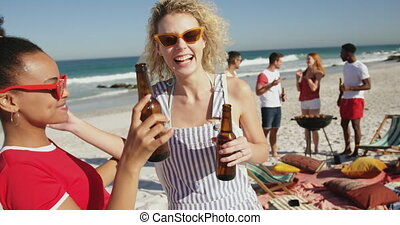 Young adult friends having a barbecue on a beach 4k