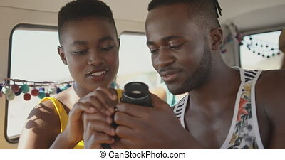 Young adult friends in a camper van 4k - Close up of a young...
