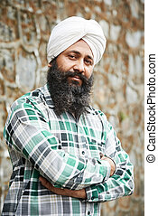 Portrait of authentic Indian sikh man in turban with bushy beard
