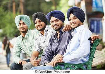 Young adult indian sikh men - Group portrait of smiling...